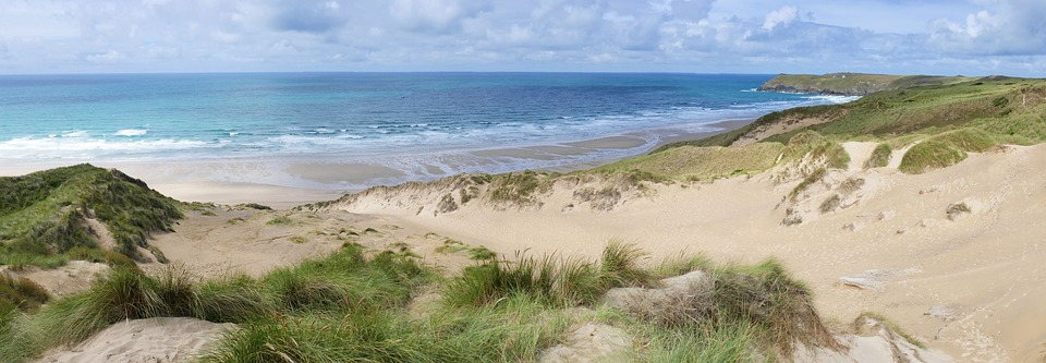 Photo of sunny solitary UK beach and sand dunes