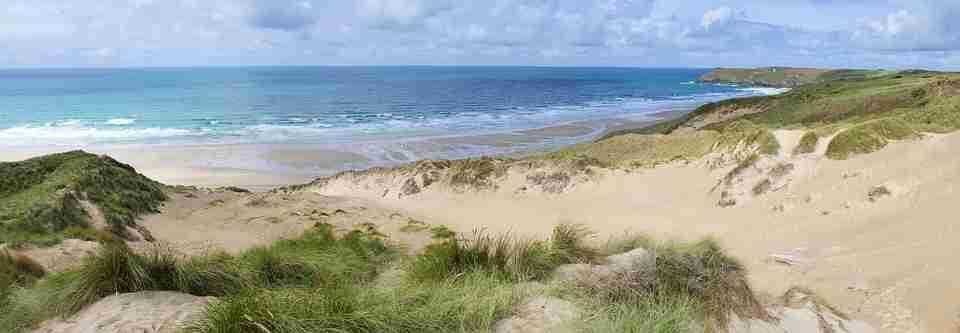 Photo of sunny solitary UK beach and sand dunes