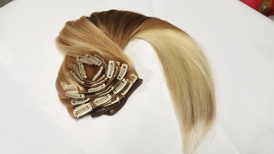 blond hair extensions on white table