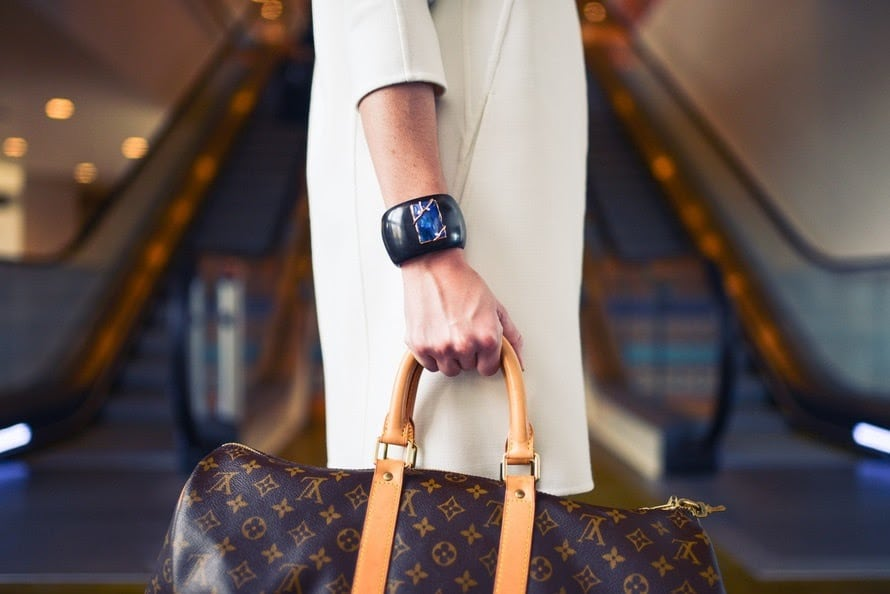 woman carrying hand luggage
