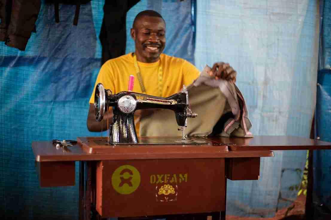 Buchumi using a sewing machine.