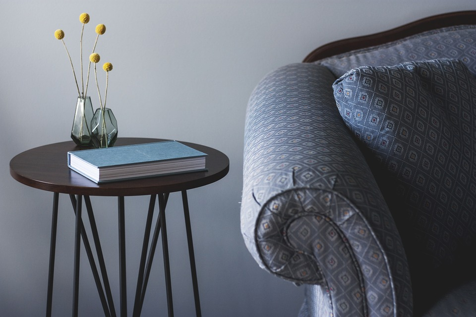 modern look: grey sofa by dark wood side table.