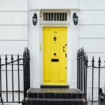 house with bright yellow door. Home hangouts.