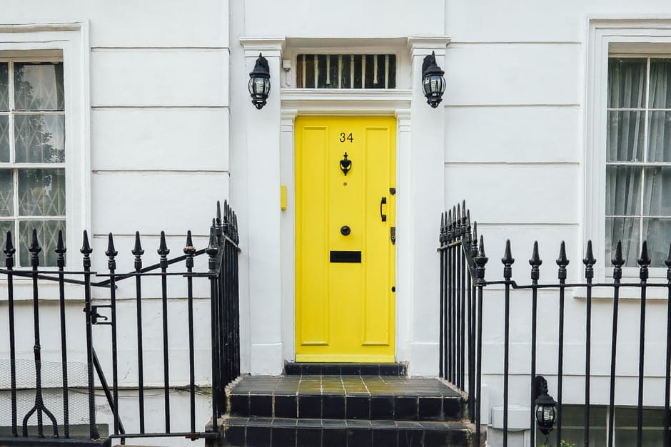 White house with yellow door: home hangouts