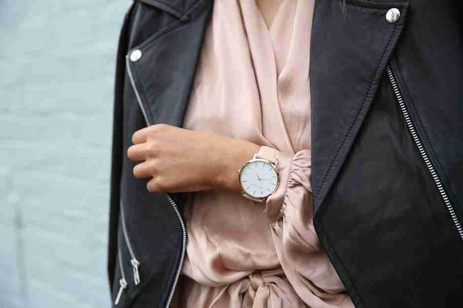 your wardrobe: woman wearing pink shirt and black jacket.