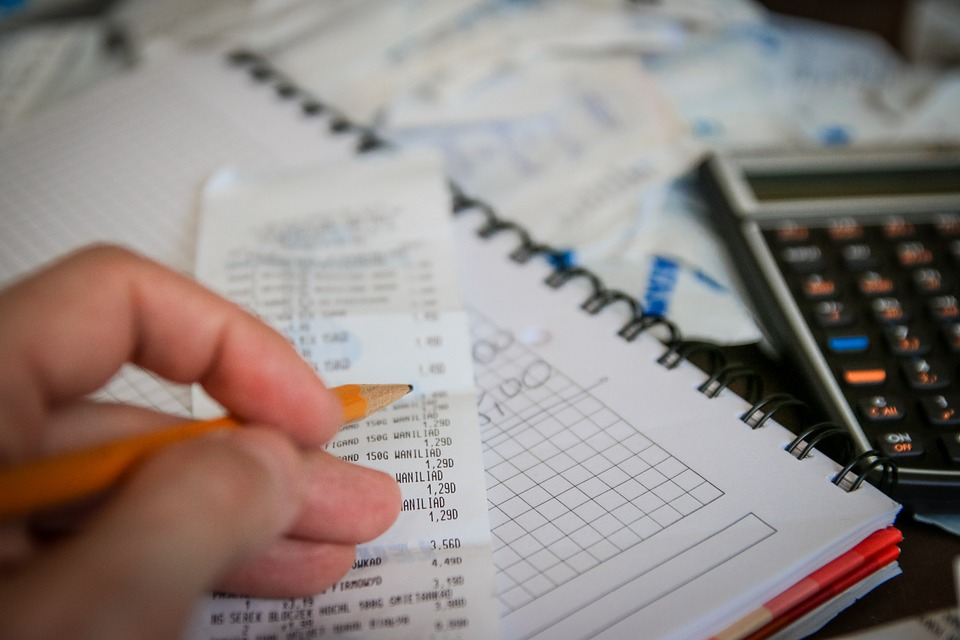 build credit: list of bills on a pad.