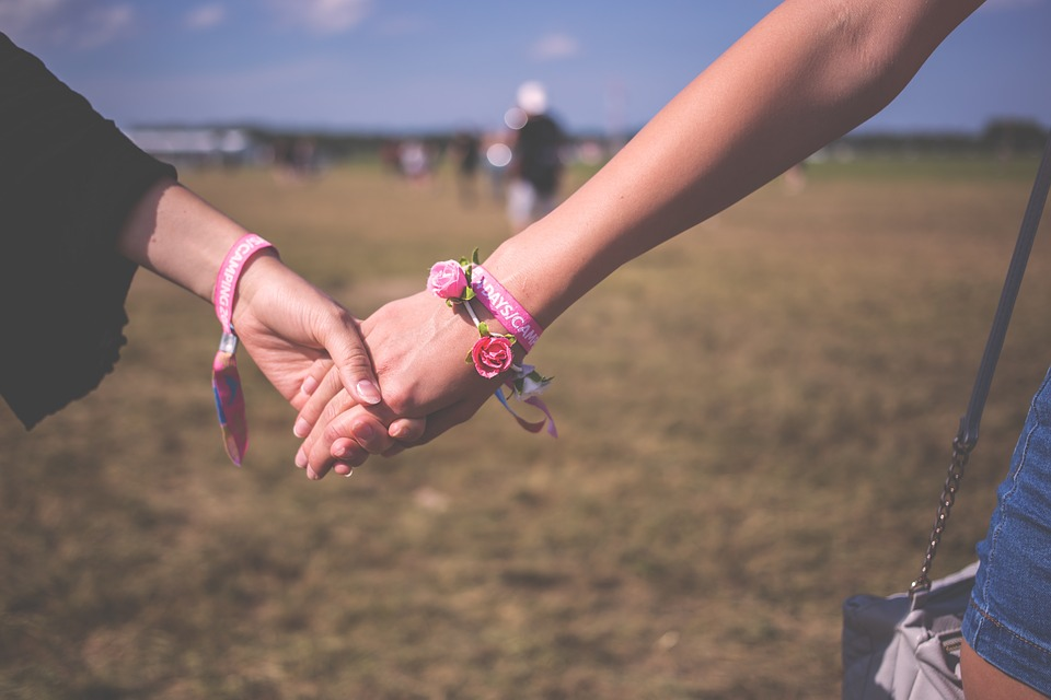 LBTQ community in Spain: 2 woman holding hands in the countryside