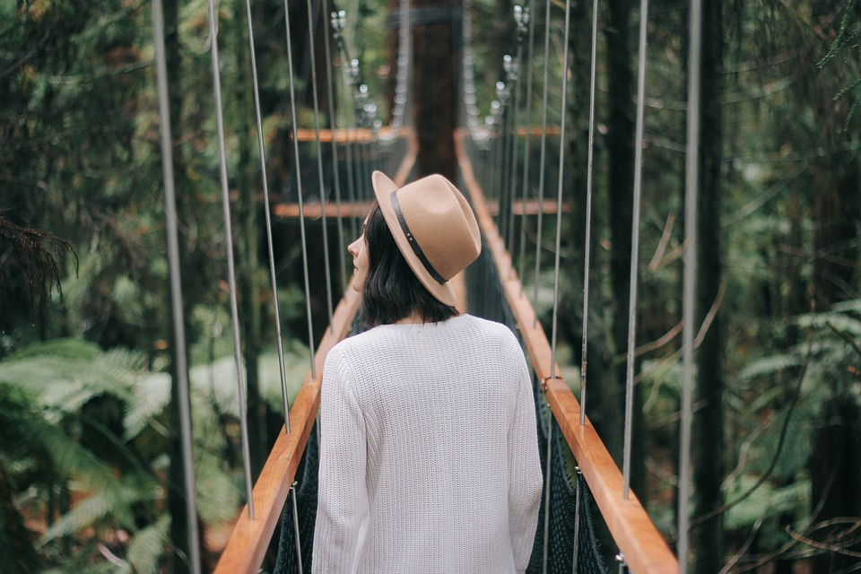 dating world: woman crossing a bridge