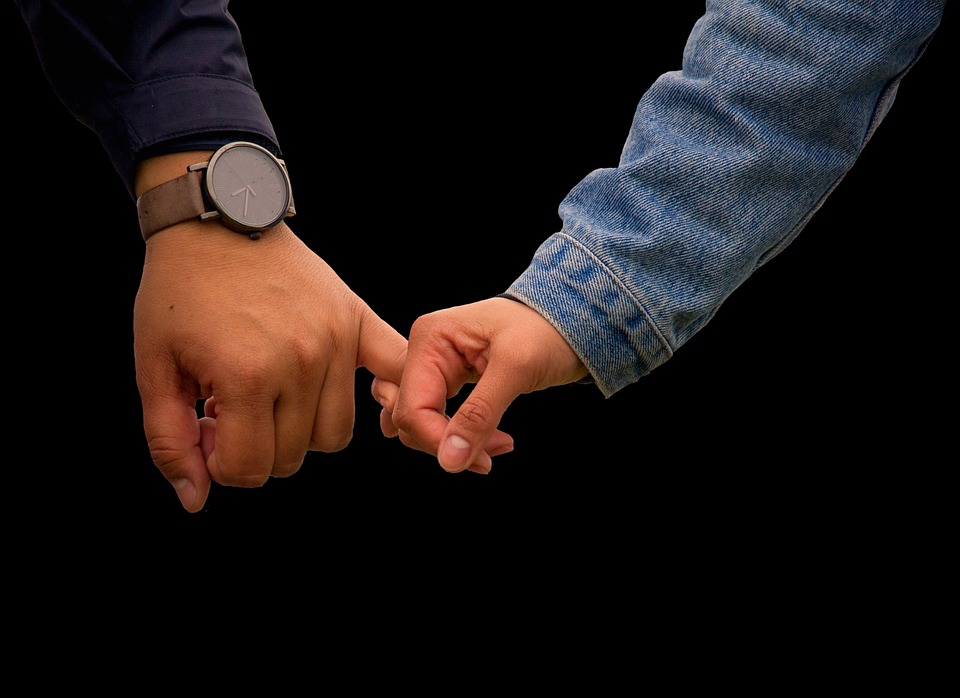 things men do: couple holding hands