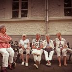 retirement village: group of older ladies sitting outside together