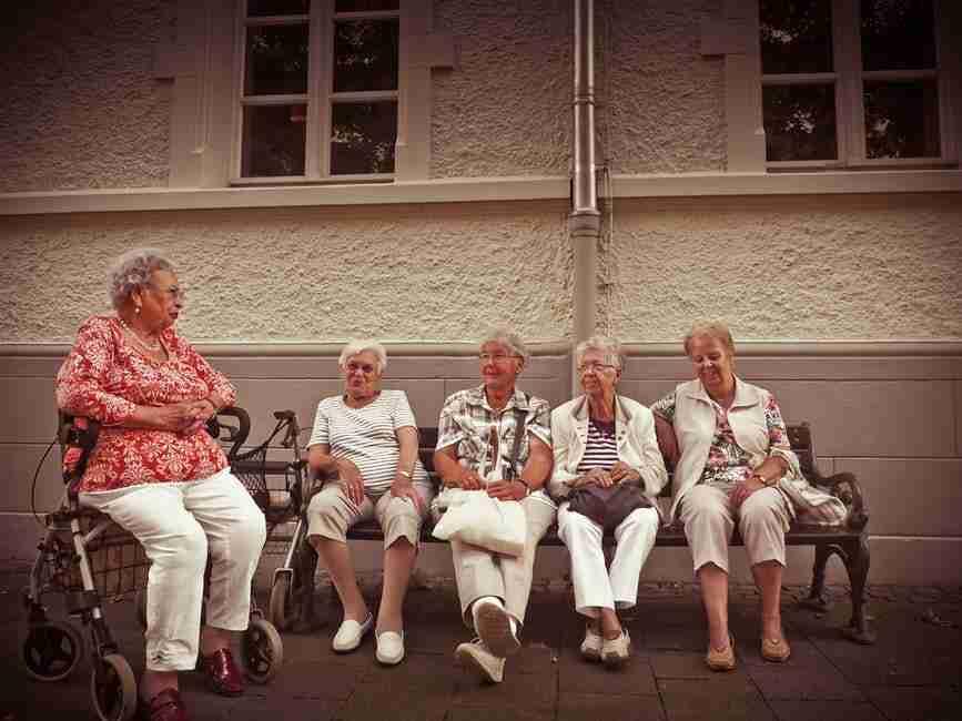 retirement village: group of older ladies sitting outside together