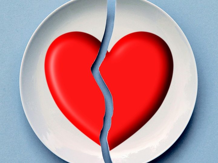 how not to break up - plate with red heart painted on it broken in half.
