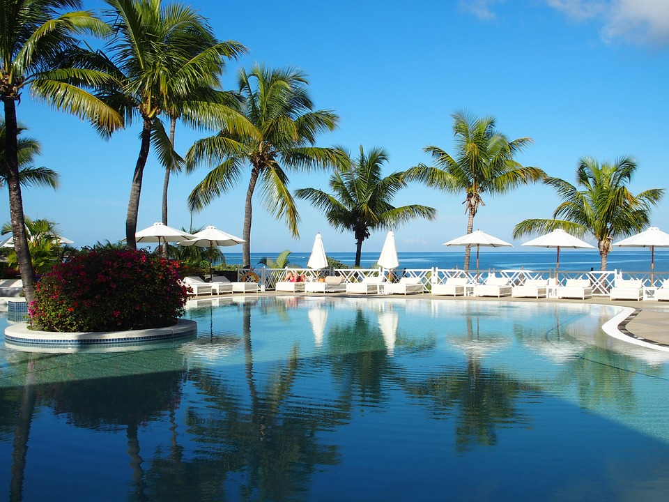 planning the perfect honeymoon: beach hotel with pool.