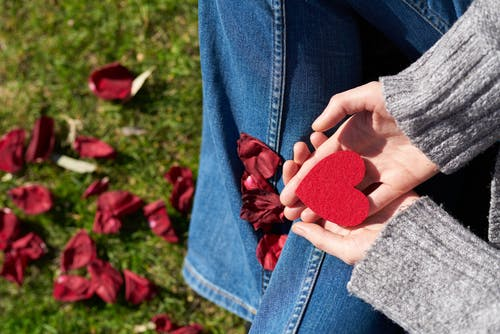 Valentine's: Woman holding a cardboard heart.