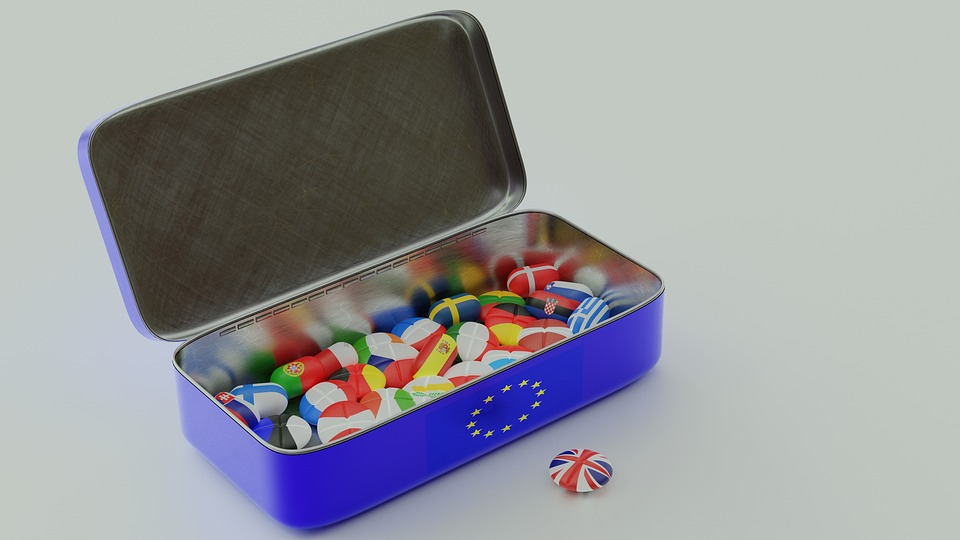 Brexit: dice in blue box each one coloured as a EU country's flag.