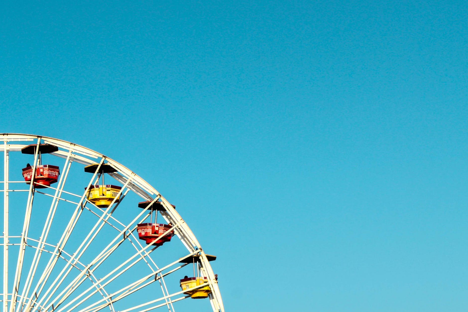 date ideas to help you bond: Feris wheel in sunshine.