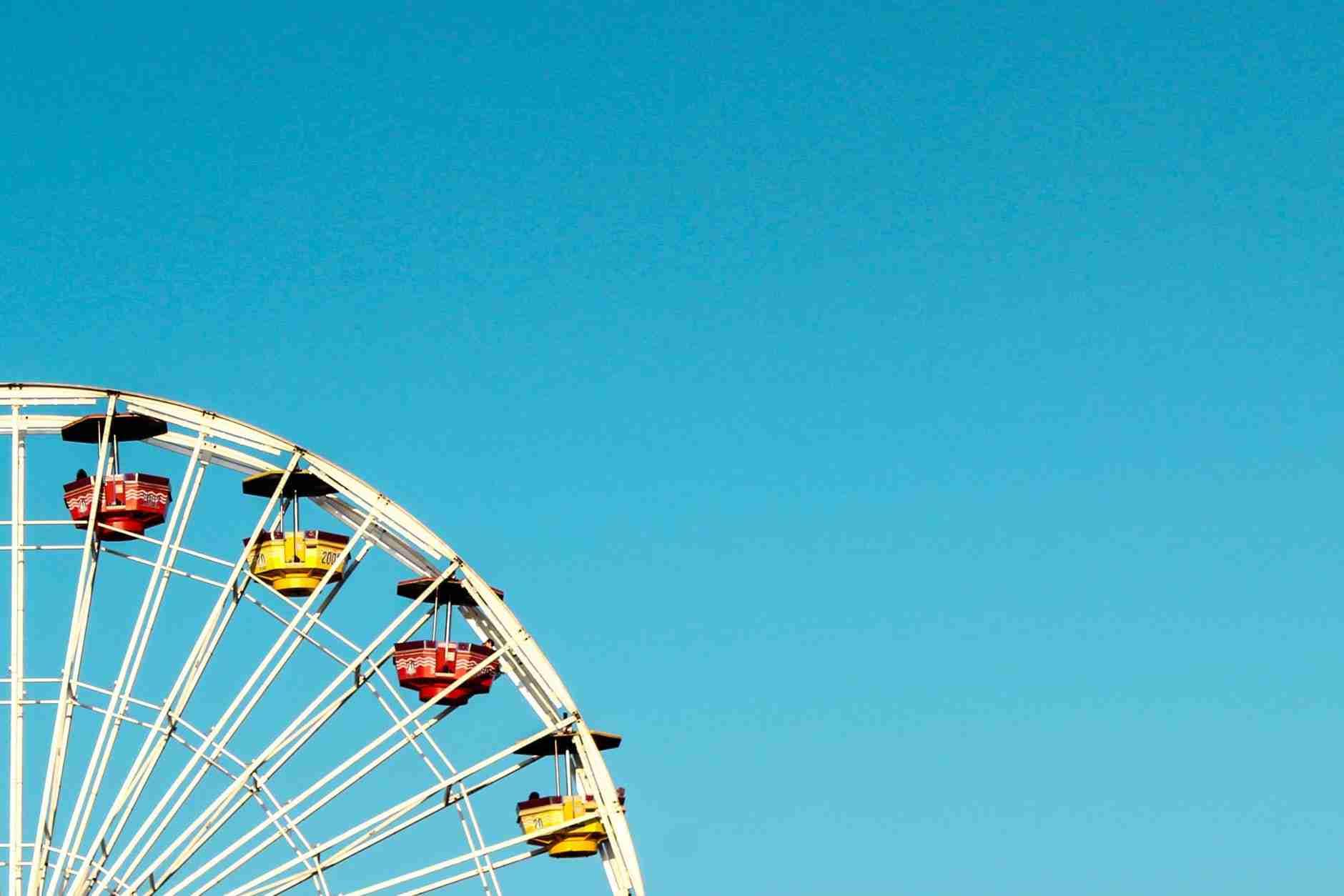 date ideas to help you bond: Feris wheel in sunshine.