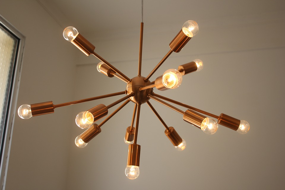 copper modern chandelier with small lightbulbs: lighting design
