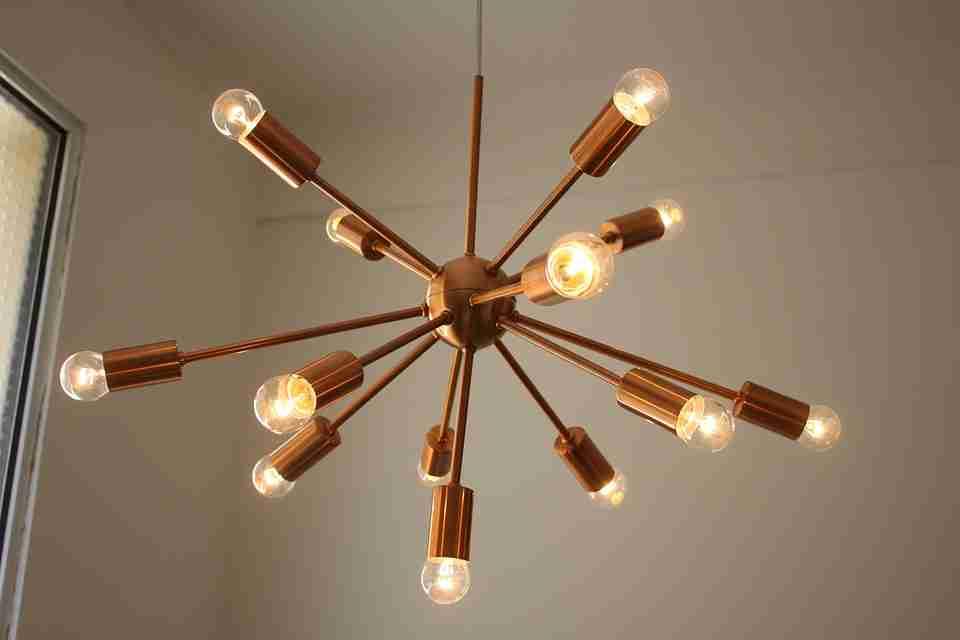 copper modern chandelier with small lightbulbs: lighting design