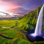Icelandic valley in evening sun. Reasons to visit Iceland.