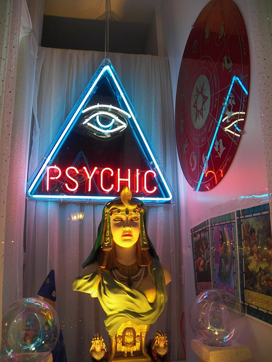 psychic abilities: statue with psychic emblazoned above it.
