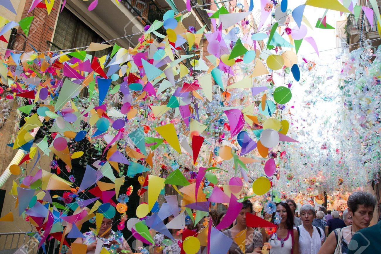Spanish summer festivals: ticker tape party in street.
