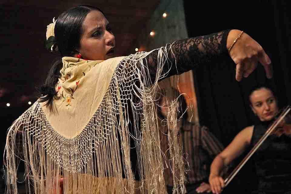Spanish summer festivals: Female Flamenco dancer performing.