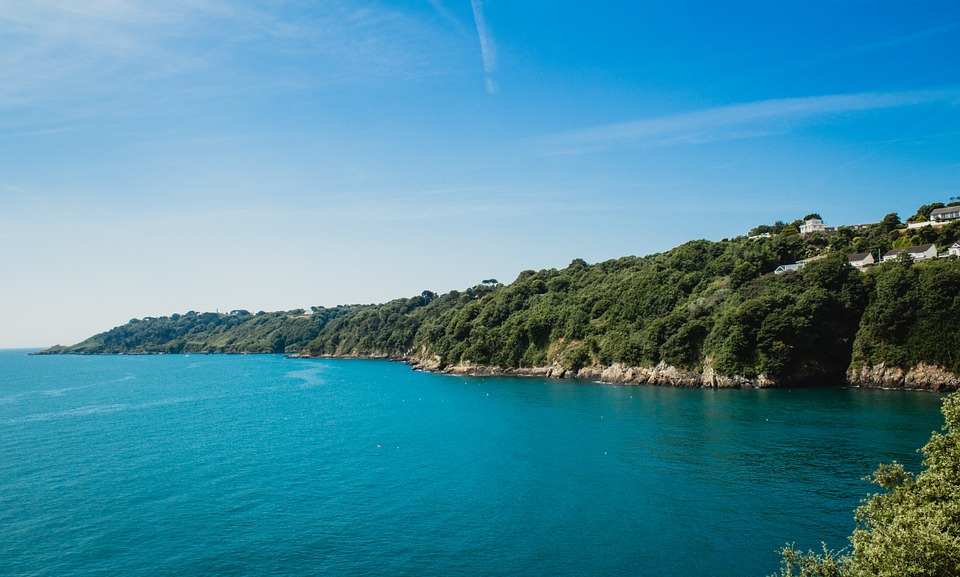 Visit Guernsey: coastline with blue sea.