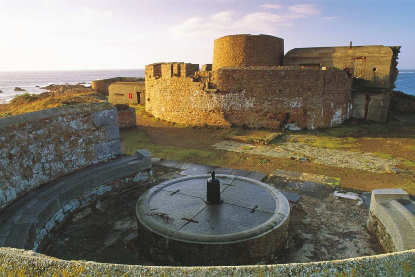 Visit Guernsey: Castle with German fortifications in grounds.