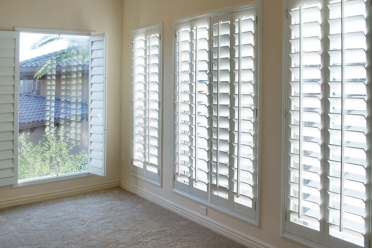 window dressing: room with lots of white shutters.