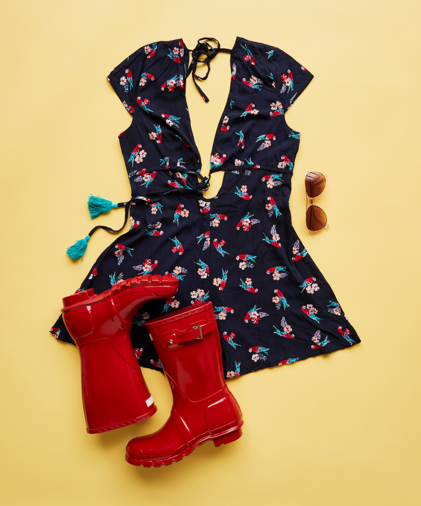 festival items: dress, red wellies, sunglasses