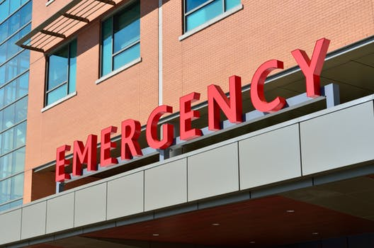 Picture of Emergency sign on hospital building: medical travel insurance