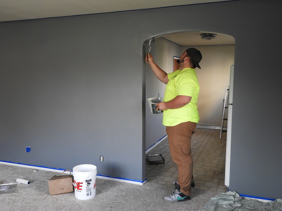 Painter painting house walls