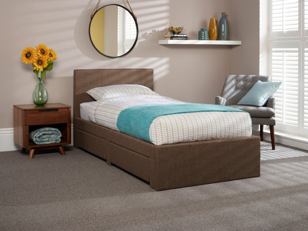 functionality: double bed  in light airy room with mirror on wall above it.