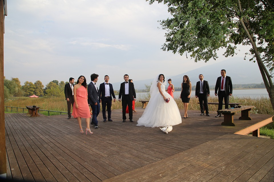 Wedding guests wearing their wedding guest outfit by a river.
