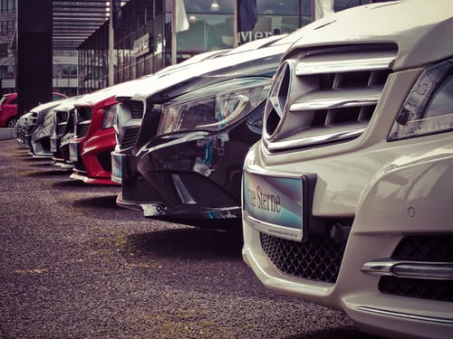 Limited company: Row of brand new cars at dealership