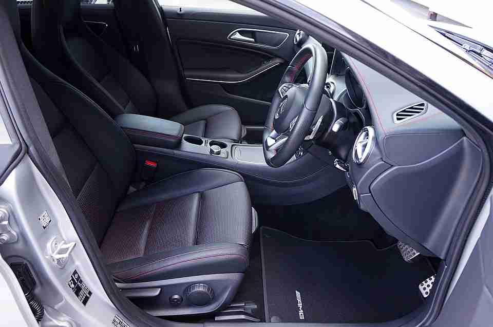 buying a new car: inside of posh car.