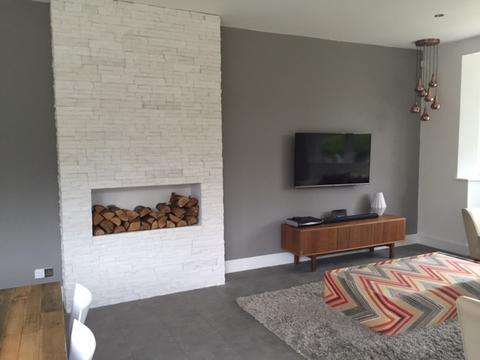 stone tiles: brick an stone tiled wall surrounding fireplace in living room.