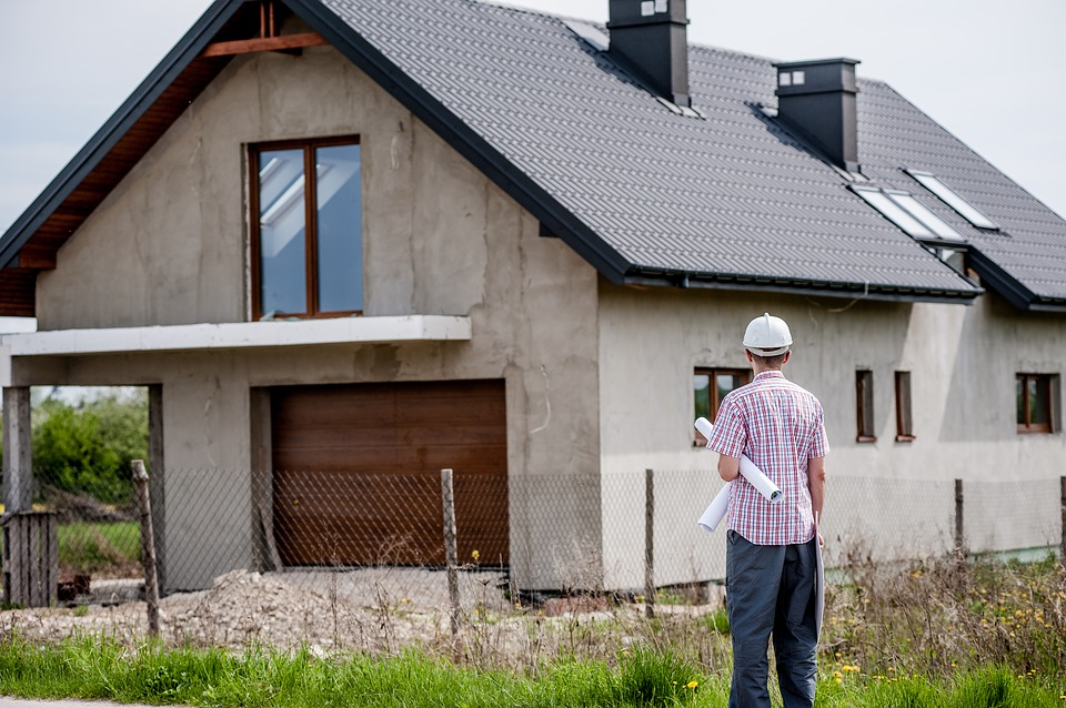 builders: house being constructed.