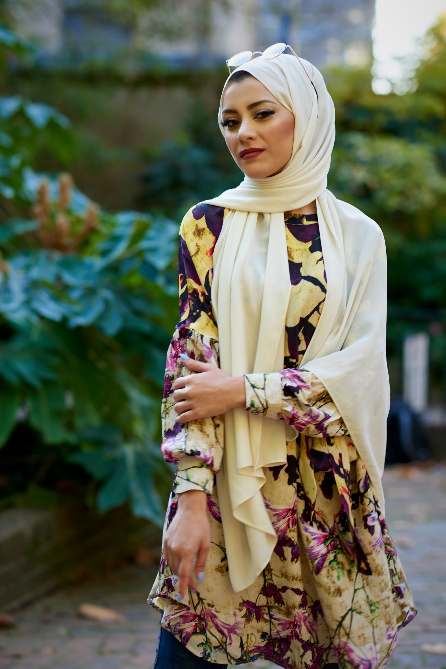 Ezelle: flowered yellow, purple and blue dress with white headscarf.
