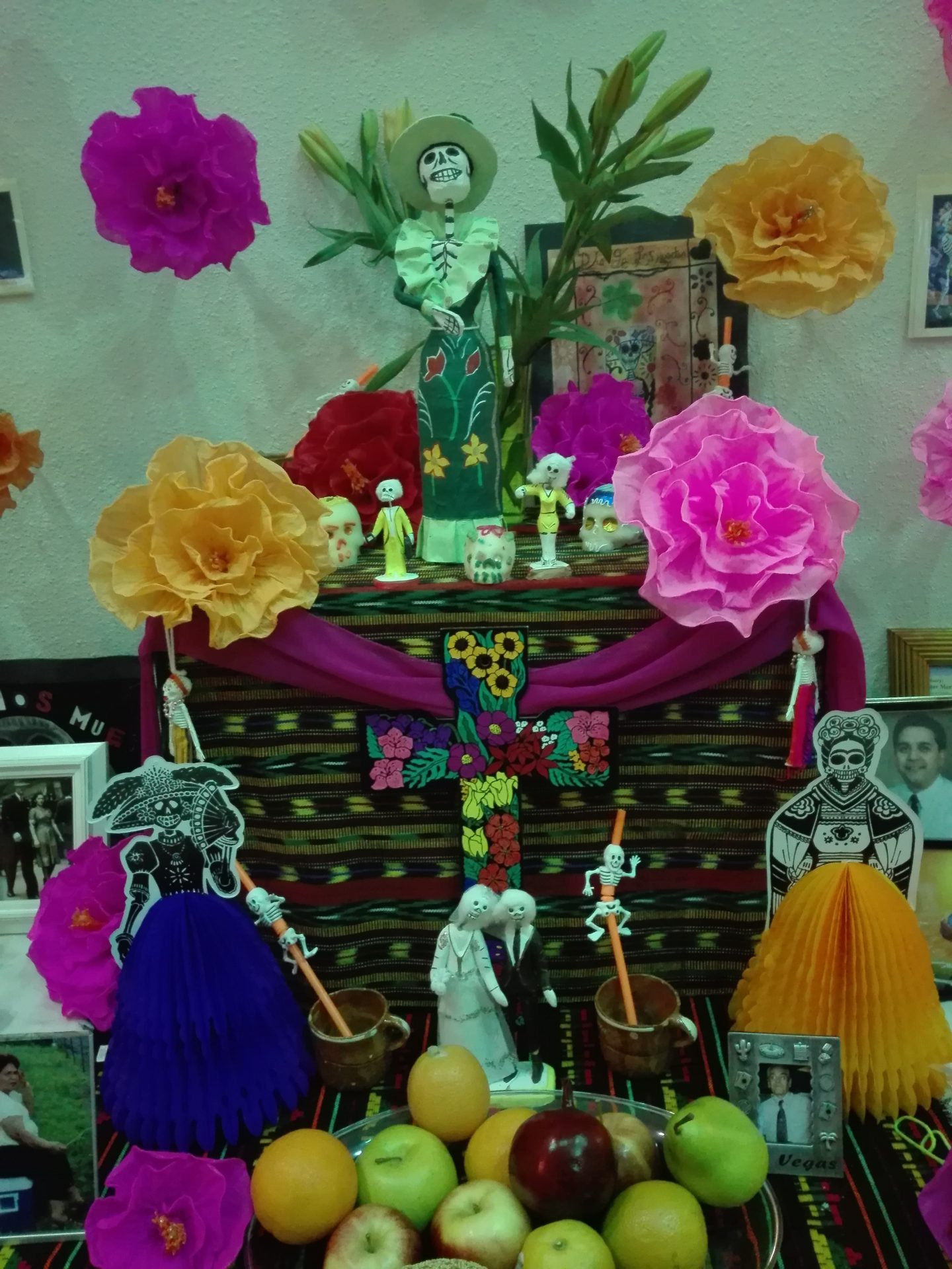 Mexican Day of the dead Altar with photos and flowers.
