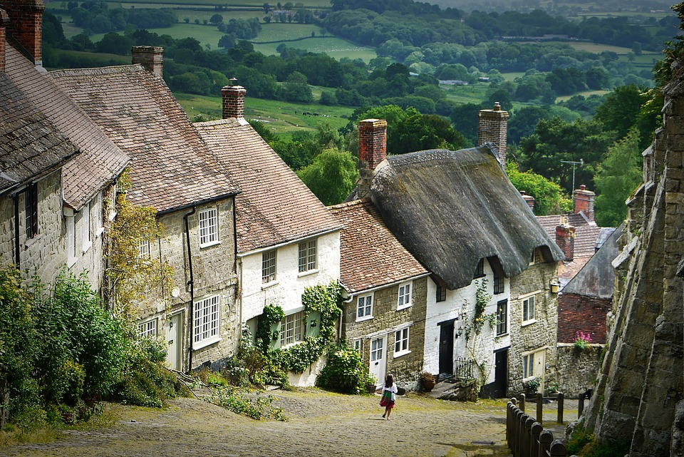 holiday abroad: hill with beautiful houses and fields in distance.