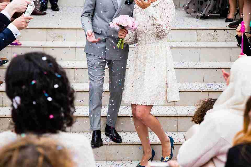 wedding essentials: couple coming down church steps.