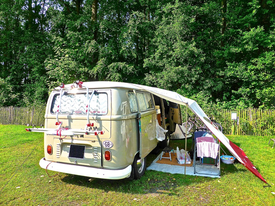 motorhome: campervan with tent over it.