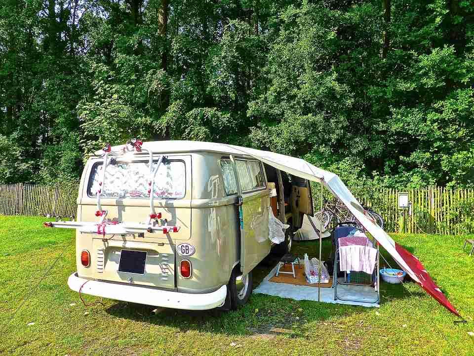 motorhome: campervan with tent over it.
