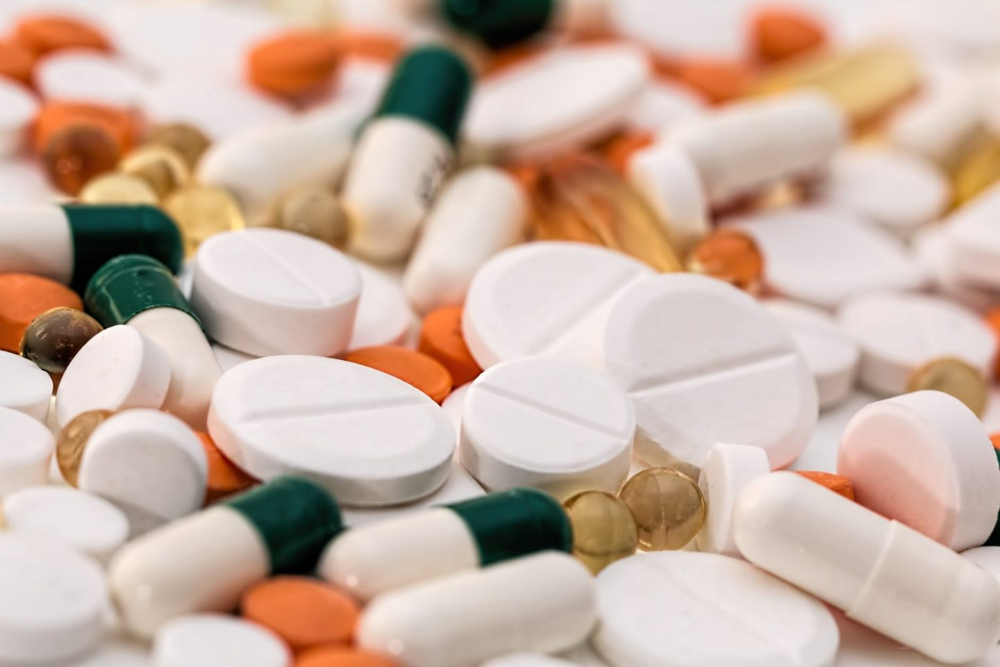 Fatigue: Assorted pills and supplements spread out on a table.