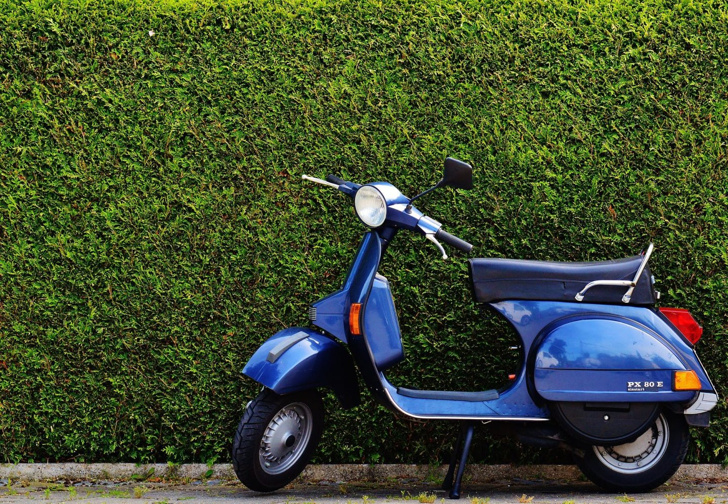 motorcycle rider: blue vespa