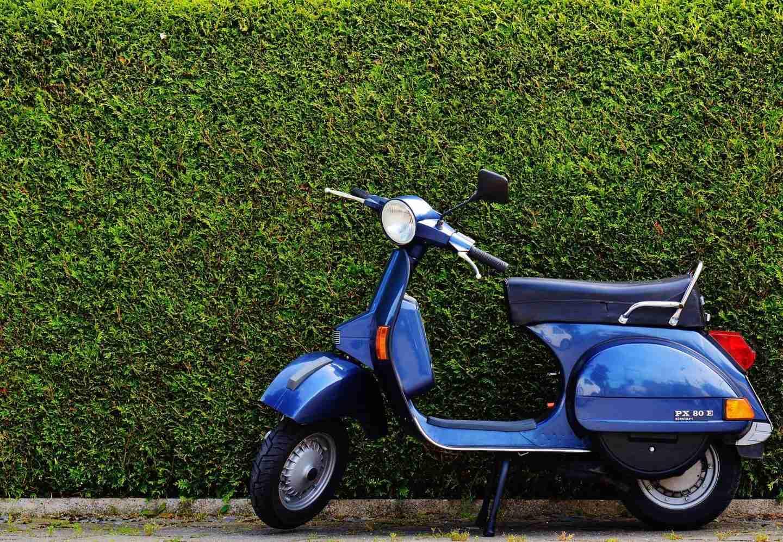 motorcycle rider: blue vespa