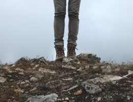 man hiking on hill..
