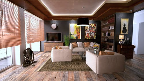 Underfloor heating: cosy room with modern white sofas and TV.